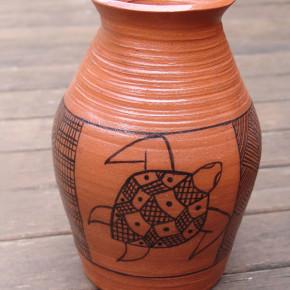 Robert Edward Puruntatameri - Tiwi Potter Looking for Clay