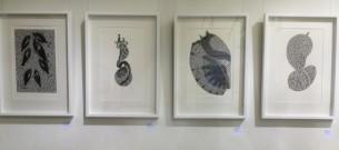 Framed TSI Vinyl Cuts on the Wall at Tali Gallery